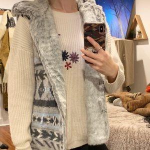 Fux fur lined, hooded vest.